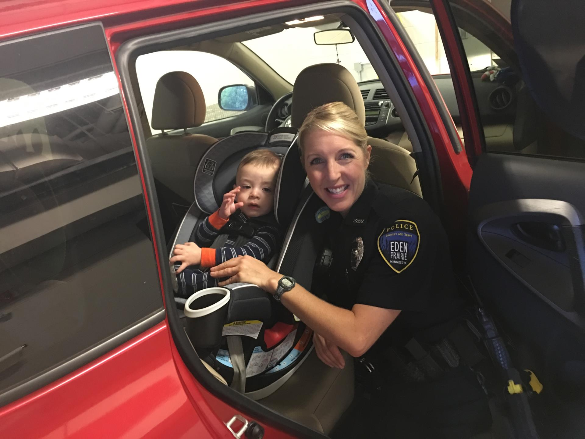 Officer Ryan Kuffel at a 2017 car seat clinic