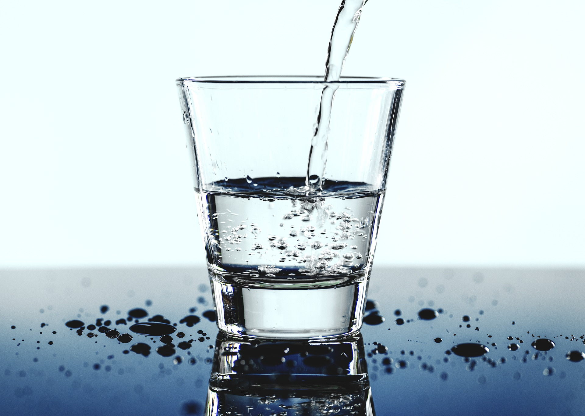 Crystal clear water being poured into a drinking glass