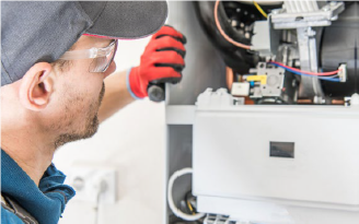 Man with safety goggles inspecting home equipment